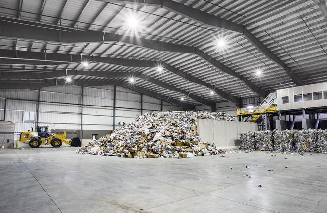 Tipping floor inside the Dem-Con Materials Recovery Facility (MRF) Metal Building