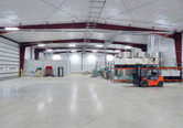 Wide view of storage, office and equipment inside River Valley bulk chemical warehouse in Speer, IL